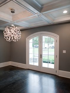 Dark floors with gray walls...love the chandelier!