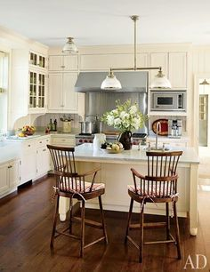 Gil Schafer designed cabinetry & antique barstools