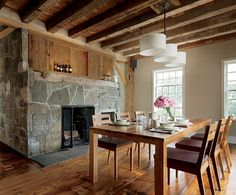 Barnwood and flagstone create a cozy dining room.