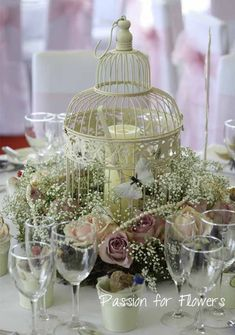 vintage roses birdcage wedding flowers