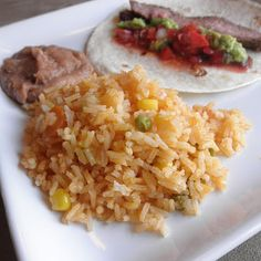 I must say, it is a contender for my favorite Mexican rice.  It tastes just like a lot of Mexican rice I've had at restaurants, and the little veggies make it really authentic.  A fantastic side for any Mexican dinner, and easy too.