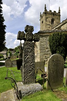 A 7th century Anglo Saxon cross in the churchyard at Eyam in the Peaks District.
