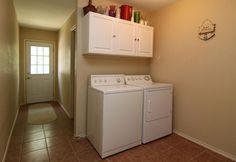 Dedicated Laundry Area with Cabinets for Storage