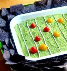 We ADORE this fun football presentation for guacamole. Get the full recipe and instructions for your Super Bowl party! | via @SparkPeople #food #recipe #appetizer #avocado