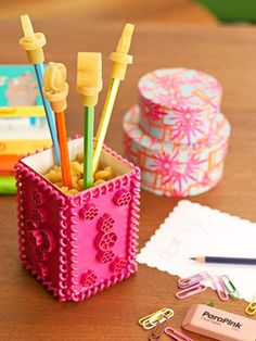 Use a milk carton, pasta, paint, & glue to create this colorful pencil cup.