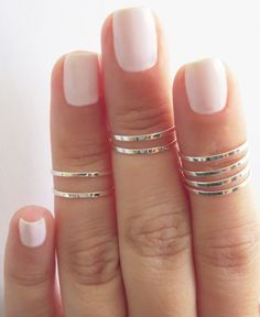 thin knuckle rings midi rings, nail polish, soft pink, fashion outfits, fashion styles, pink nails, nail colors, pale pink, knuckle rings