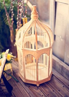 I like the idea of using a vintage birdcage to hold cards on the big day.
