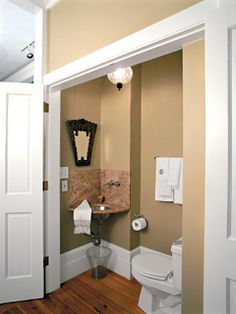 from Southern Living via My Home Ideas  Great solution for our tiny powder room?