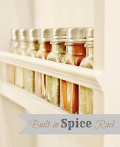 60+ Innovative Kitchen Organization and Storage DIY Projects - Build in a spice rack to save space and give your kitchen a little decor boost. You just need a few boards and maybe some decorative molding. You can build the spice rack wherever you have a small wall and even leave room at the top or bottom for decorative plates.