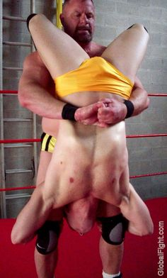 wrestling man getting piledrived during pro match
