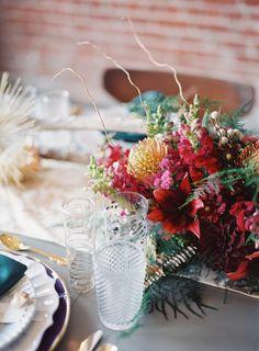 tropical inspired centerpiece, photo by Amanda Watson, styling by Emerson Events http://ruffledblog.com/mixed-metals-summer-wedding-inspiration #weddingideas #centerpieces