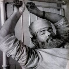 Hemingway recovers in a London hospital in 1944 after an automobile accident.
