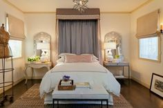 Interesting headboard and the different style of bedside tables lend a bit of intrigue to the space.
