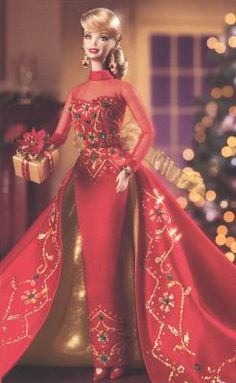 Porcelain barbie-I have this one. I should display my Christmas barbie dolls one day.