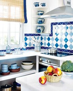 Blue kitchen - Handmade tiles can be colour coordinated and customized re. shape, texture, pattern, etc. by ceramic design studios