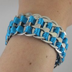 A bracelet made of ribbon and soda can pop tabs! So awesome!
