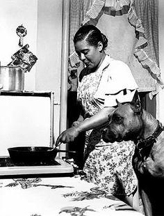 Billie Holliday cooking a steak for Mister 1949