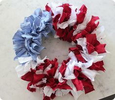 4th of July wreath with red, white, and blue cloth strips tied on...