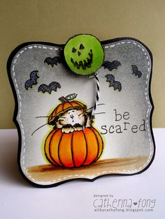 handmade Halloween card ... label shaped ... adorable cat in a pumpkin image ... green Jack-o-Lantern balloon ... chubby bats ... colored pencil coloring ... great card!