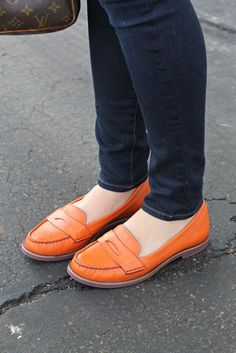love the orange cole haan loafers via bows & sequins