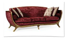 Draped in maroon velvet, the sofa is a contemporary interpretation of the Louis XV design with original details such as intricate leg carvings and classic French Rococo silhouette.