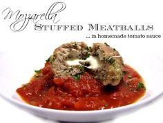 Mozzarella Stuffed Meatballs in homemade tomato sauce!  Delicious!