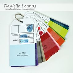 It is Danielle Lounds popping in with a quick spotlight on making a tag book of Bazzill Card Shoppe cardstock swatches complete with coordinating Copic marker matches.  There are also spots for adding ink matches and Distress Marker matches.