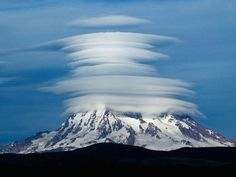 Mount Rainer behind lenticular clouds. @Evan Sharp - be careful up there!