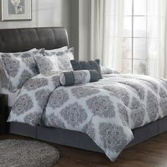 "Bring a luxe touch to your master suite or guest room with this stylish comforter set, showcasing a medallion-inspired motif.   Product: Queen: 1 Comforter, 2 standard shams, 1 bed skirt and 3 accent pillowsKing: 1 Comforter, 2 standard shams, 1 bed skirt and 3 accent pillowsConstruction Material: PolyesterColor: Silver and chocolateFeatures: Accent pillows include insertsDimensions: Square Accent Pillow: 16"" x 16""Lumbar Accent Pillow: 12"" x 16""Roll Accent Pillow: 6"" x 16""Standard Sham: 20"" x …"