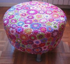 Freeform Irish crochet lace work to form an ottoman or a foot stool