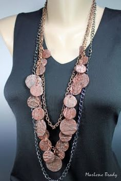 Marlene Brady's free tutorial for making a texture mold from wallpaper and then making a necklace from it.