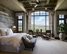 Barnwood accent wall - gorgeous ceiling - gorgeous windows - essentially my dream master bedroom