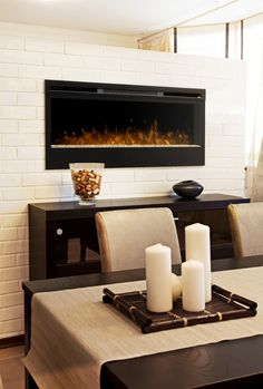 In wall electric fireplace in white brick wall