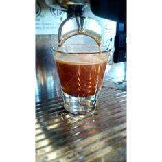 """This picture is of our shot glass being utilized by pulling a shot of freshly tamped espresso. "" - Paul P. from Riverflats Coffee and Tea shot glass, tea"