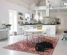 industrial lights, vintage rug - love this space