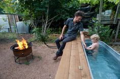 I want my own DIY hot tub!!....Jesse Hartman (L) has created a backyard space that reflects his creativity and resourcefulness. His son Harvey enjoys the homemade hot tub, that is heated by water pumped through the coils in the fire pit Hartman fashioned.