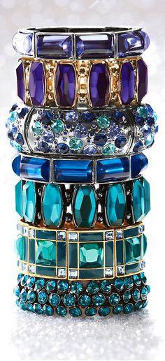 Jeweled bracelets stacked