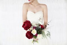 Dark red peony and rose bouquet. Perfect for a Fall or Winter wedding   Photo by Feather and Twine
