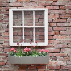 DIY idea with an old window with flower box...This would look so cute on a shed