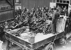 Denmark 1945 - cheerful looking German soldiers surrender their weapons as Denmark is liberated by British troops.