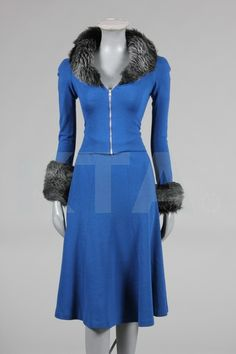 A Biba royal blue jersey skirt suit with faux fur trim, circa 1973.