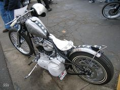 Panhead hardtail springer custom with finned primary cover and bare metal & stars paintjob