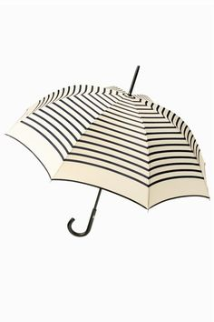 Guy de Jean / striped long umbrella by Jean Paul Gaultier.