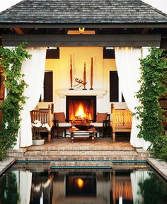 outdoor living // fireplace // pool // pool house