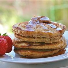 "Quick Oatmeal Pancakes | ""Include quick-cooking oats to your pancake batter for a hearty addition to the breakfast plate. Serve with your favorite sweet topping."""