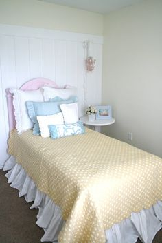 Yellow and blue bedroom with pink headboard. #girlrooms #yellowquilt #girlybedding