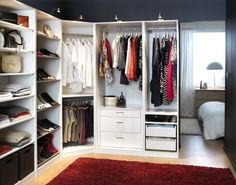 PAX wardrobes with KOMPLMENT interiors organize everything from sweaters to scarves, giving you an easy overview of your closet.