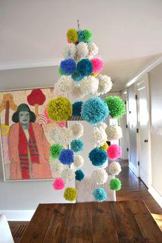 Pom Pom chandelier!  (DIY instructions can be found here:  http://smallforbig.com/2013/05/diy-pom-pom-chandelier-neon-yarn-craft-mobile.html)