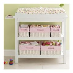 Love the baskets in the changing table