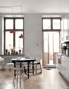 wood framed windows with concrete colored walls, spindles on table